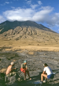 View of Oldoinyo Lengai from base camp, with Barry Dawson, Celia Nyamweru and Gill Norton.