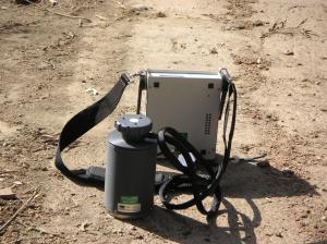 Soil gas measurement using an accumulation chamber, with a PP systems chamber and portable gas analyser.