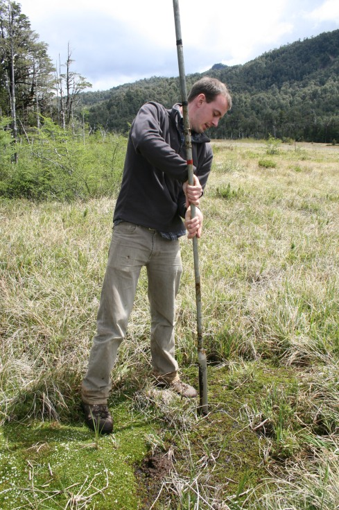 Sampling a peat bog in southern Chile.